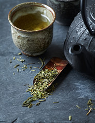 Sencha leaves on a sakura (cherry bark) tea spoon