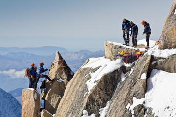 Alpine climbers climbing on a rock in the Mont Blanc massif