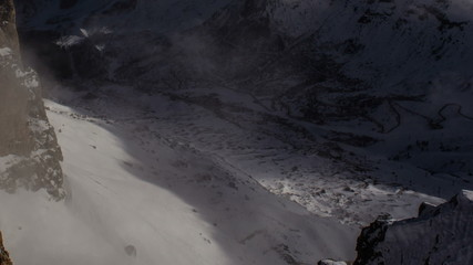 Mountain road in Pordoi Pass winter clouds  Dolomite Alps