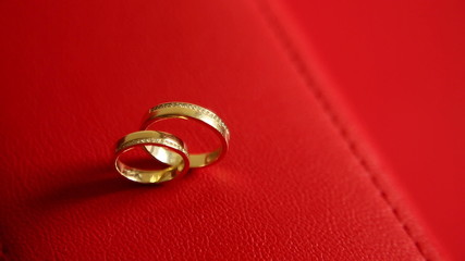 Wedding rings on a red background