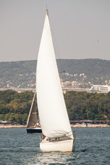 Sailing yacht with white sails
