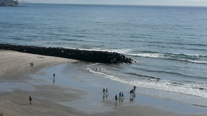 View of people walking on the beach
