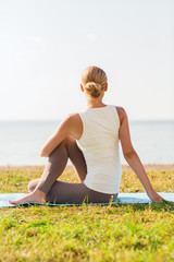 woman making yoga exercises outdoors