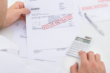 Man Calculating Invoice