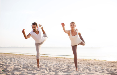 couple making yoga exercises outdoors