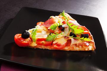 Colorful pizza piece.