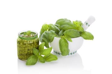 Basil pesto with ingredients.