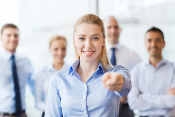 smiling businesswoman pointing finger on you