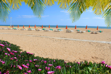 Albufeira beach with flowers and chairs