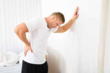 Young Man Having Pain In His Back