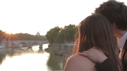 two lovers admire the sunset, with the background of St Peter - sunshine