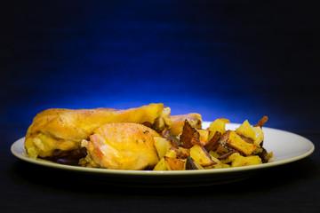 Cosce di pollo al forno con contorno di patate
