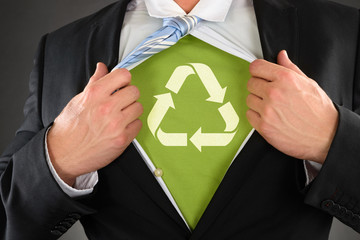 Businessman Showing Recycled Symbol Under His Shirt