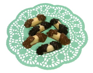 Chocolate and marzipan on a green filigree doily