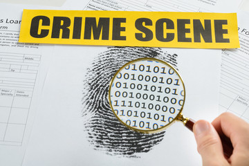 Person Hand With Magnifying Glass And Crime Scene Tape