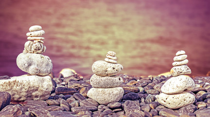 Color filtered image of stones on beach, spa concept background.