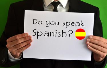 Businessman showing a sheet with text Do you speak Spanish