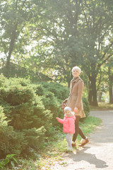 Beautiful Mother And Baby outdoors. Nature. Beauty Mum and her