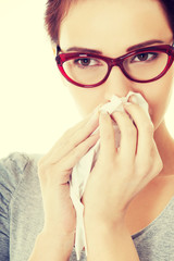 Young beautiful woman having runny nose