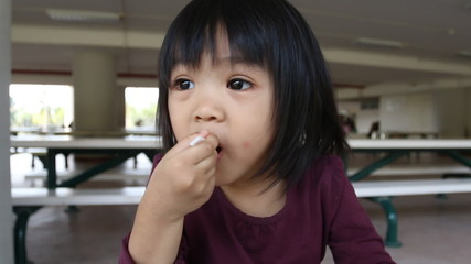 Asian baby happy to eating ice cream