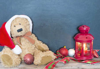 Christmas decoration with old bear, balls and lamp