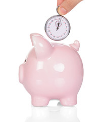 Hand Depositing Time In Piggy Bank