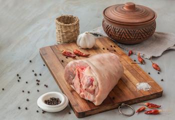 Piece of pork shank on a cutting board