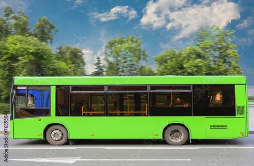 Leinwanddruck Bild city bus moves down the street