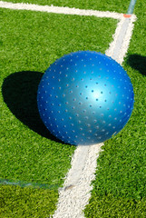 Blue Space Gym Ball on Astro Turf Pitch