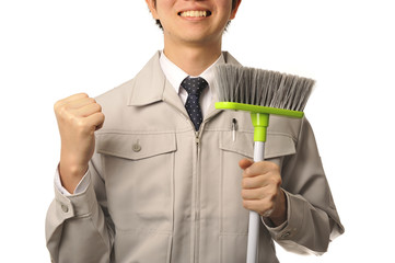 作業服を着ている笑顔の男性清掃員