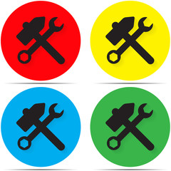 Hammer and wrench set on colored backgrounds