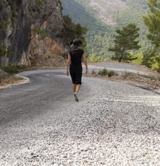 Man and woman hikers trekking roads in Turkey