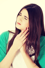 Young woman having toothache.