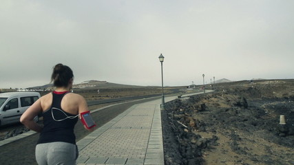 Woman jogging through boardwalk