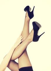 Beautiful long woman's legs in black high heels.