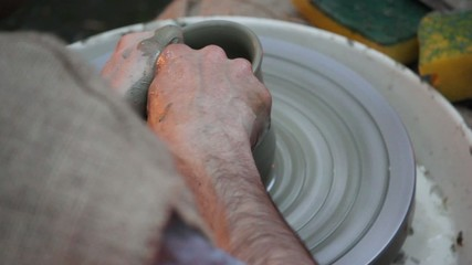 ancient potter - pot on the rotor wheel-C