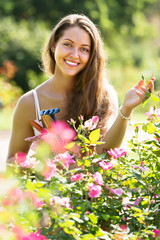 Female florist in summer garden
