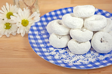 powdered sugar donuts with daisy bouquet