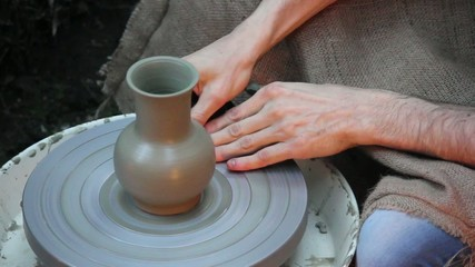 ancient potter - pot on the rotor wheel-A