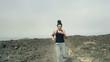 Portrait of happy woman jogging on desert