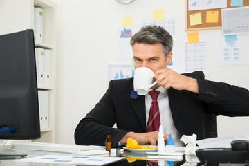Sick Businessman Drinking Lemon Tea
