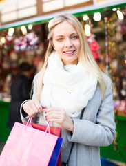Blonde shopping at Christmas market