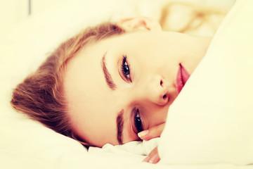 Beautiful caucasian woman lying in bed