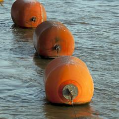 Orange Buoy Floating In Ocean