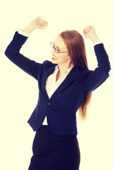 Business woman with her hands up. She's satisfied.