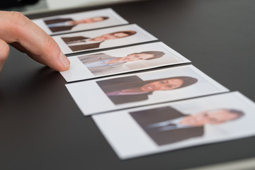 Person Choosing Photograph Of A Candidate