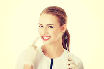 Beautiful dentist woman with equipment.