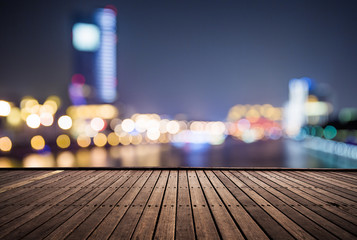 wooden platform and lights of night city