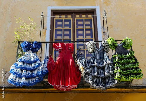 Traditional flamenco dresses at a house in Malaga, Spain - 76603470