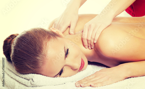 canvas print picture Beautiful woman is lying on massage table